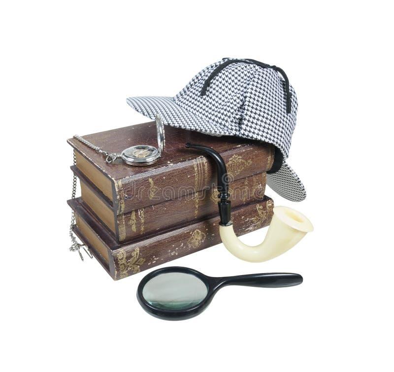 Livros do mistério com o relógio do chapéu, da lente de aumento, da tubulação e de bolso fotos de stock