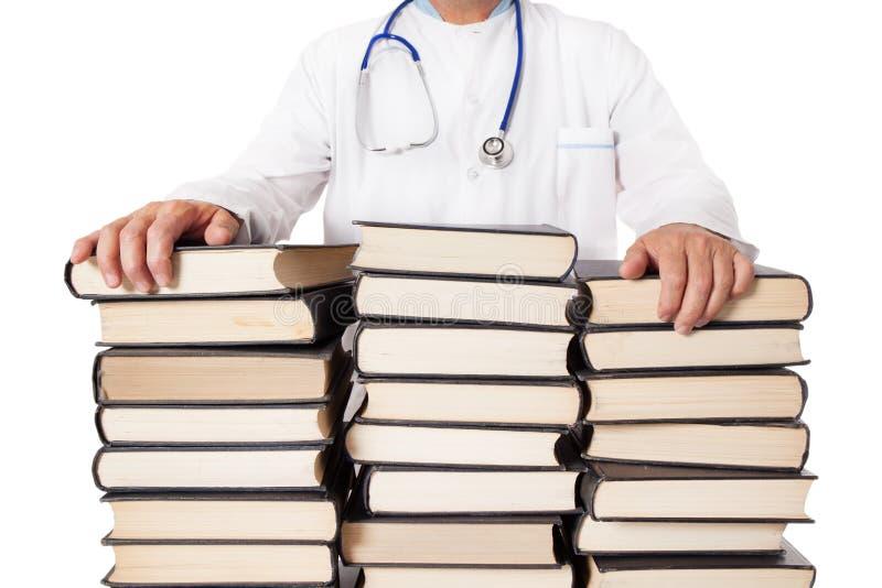 Livros e livros de texto do doutor And Many Stacked imagem de stock