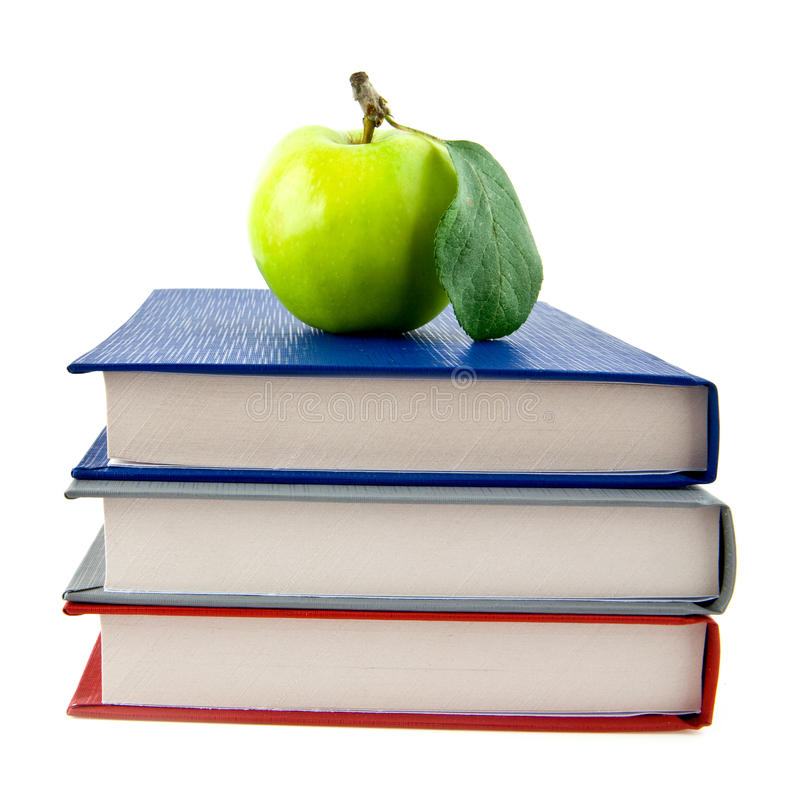 Livros e maçã imagens de stock royalty free