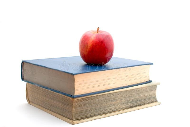 Livros e maçã foto de stock royalty free
