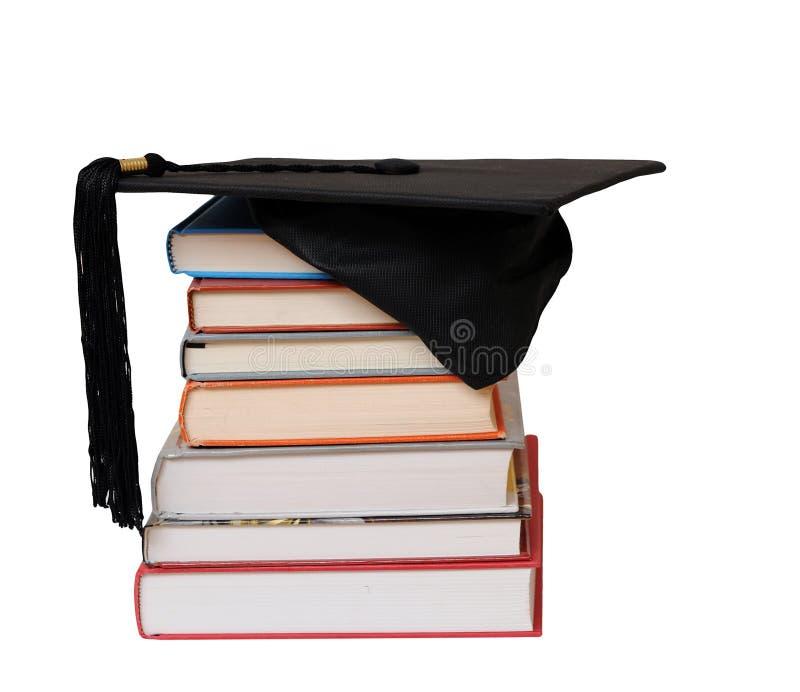 Livros e tampão educado imagens de stock royalty free