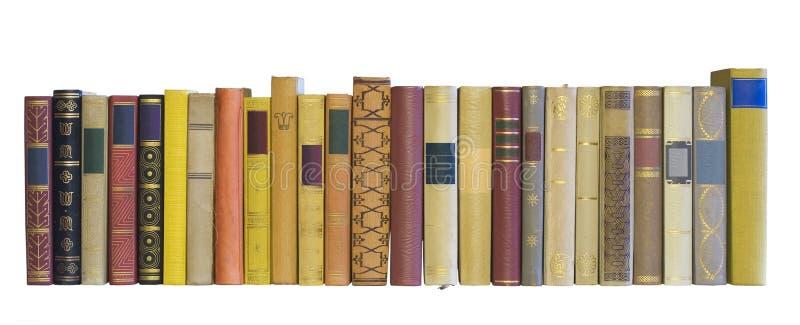 Livros em uma fileira imagem de stock