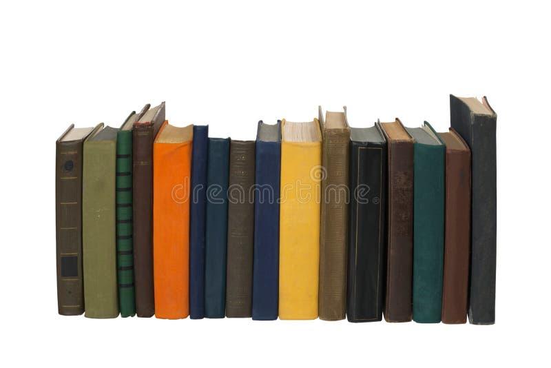 Livros empilhados velhos no fundo branco fotos de stock royalty free