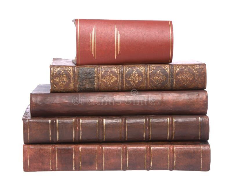 Livros encadernados de couro velhos com o um livro largo fotografia de stock