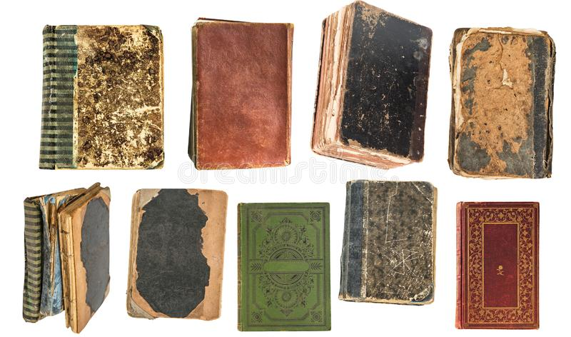 Livros muito velhos do vintage isolados no fundo branco Biblioteca velha fotografia de stock royalty free