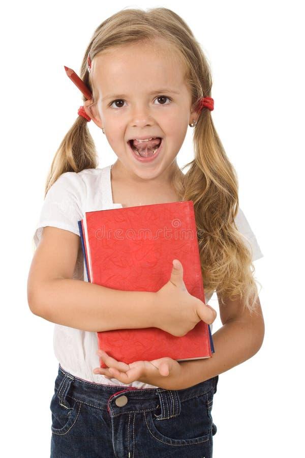 Livros prées-escolar pequenos da terra arrendada da menina foto de stock
