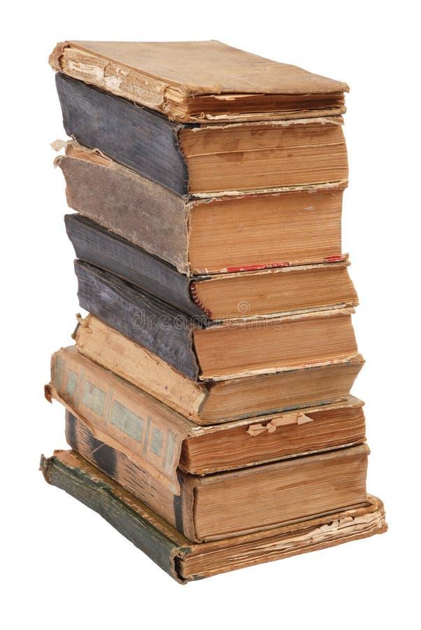 Livros velhos empilhados da forma e da cor diferentes fotos de stock royalty free