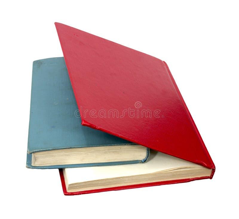 Livros vermelhos e azuis fechados imagem de stock royalty free