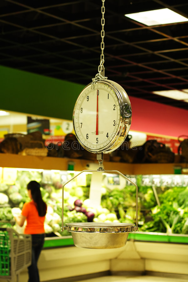 livsmedelsbutikscalevikt royaltyfri bild