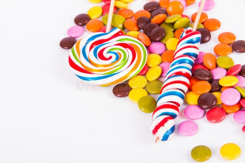 Lizaka cukierek na kiju z Małymi Sugars obraz stock