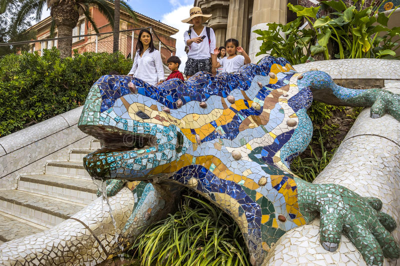 Lizard of Gaudi in Barcelona. BARCELONA, SPAIN - JULY 3, 2016: Lizard of Gaudi mosaic in park Guell in Barcelona. Park Guell (1914) is the famous architectural royalty free stock image