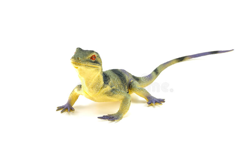 Lizard toy isolated on white. Background stock images