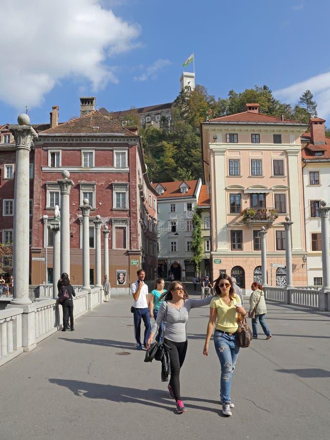 Ljubljana Autumn. Ljubljana, Slovenia - October 12, 2014: Tourist Walking Over Pedestrian Bridge Old Town in Ljubljana, Slovenia stock photography
