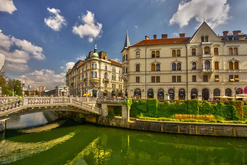 Ljubljana city center with river Ljubljanica with triple bridge stock photos