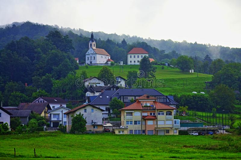 Ljubljana outskirts pastoral scenery scenic view Slovenia Europe. Pastoral view of a traditional settlement in the outskirts of Ljubljana seen from A2 motorway stock images