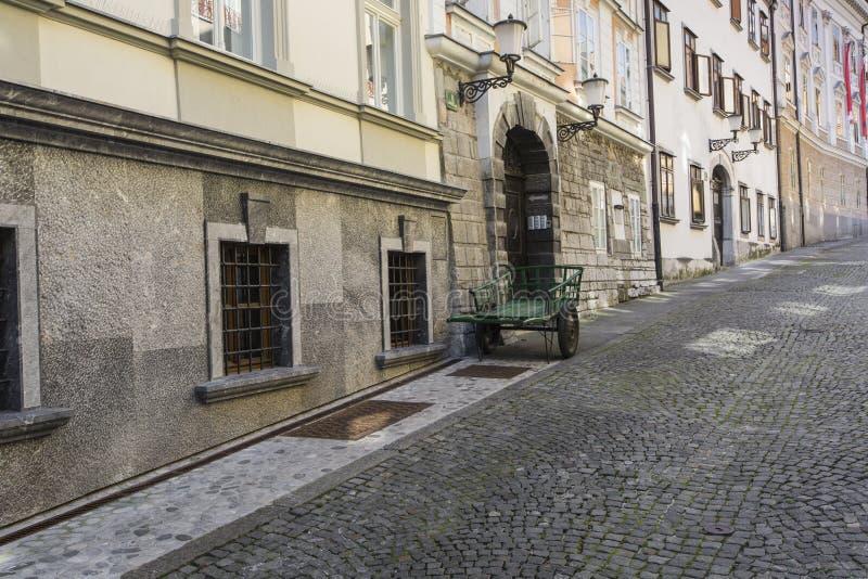LJUBLJANA, SLOVENIA - SEPTEMBER 24, 2016: Beautiful street in old city centre near the city hall in Ljubljana. Ljubljana is the c royalty free stock images