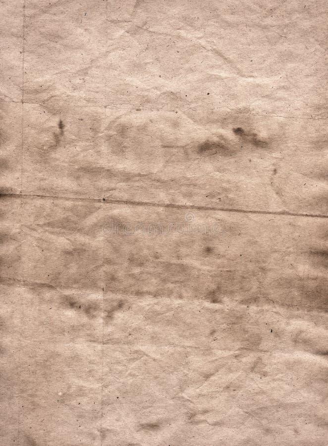 Ljus återanvänt pergament för grunge brunt med fläckar arkivbild