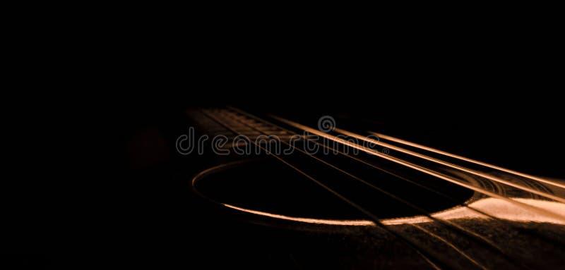 Ljus av gitarren fotografering för bildbyråer
