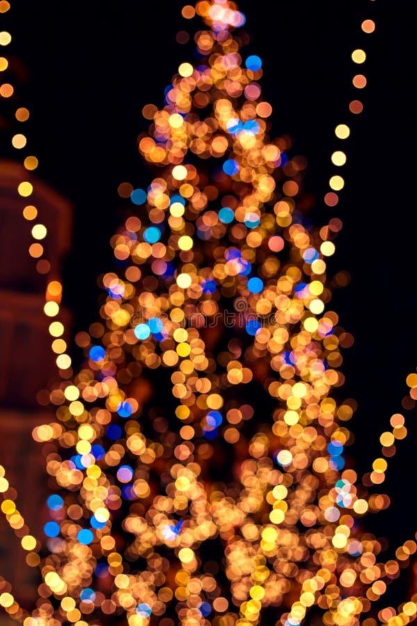 ljus beröm på julträd royaltyfri bild