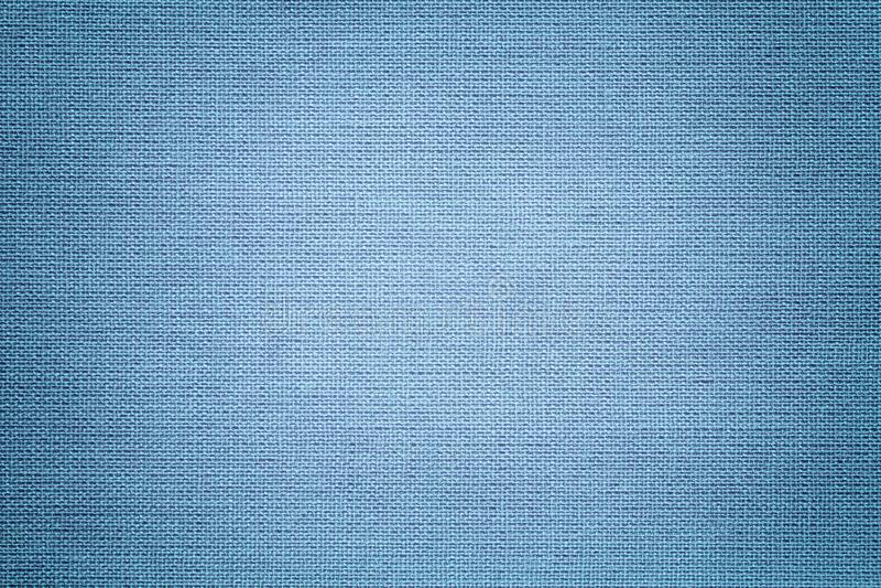 Ljus - blå bakgrund från ett textilmaterial Tyg med naturlig textur _ royaltyfri bild