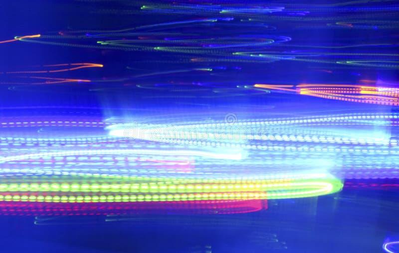 Ljus blå bakgrund med neonljus i rörelse royaltyfri illustrationer