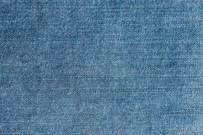 Ljus - blå grov bomullstvill royaltyfria foton