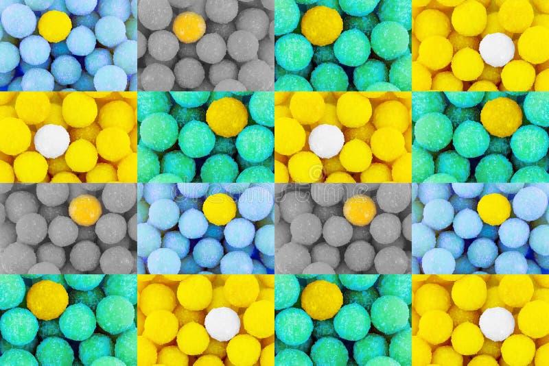 Ljus för modelluppsättningingrepp - gul godis för grön mintkaramell som är special bland många blå grå färgrik bakgrund för neutr royaltyfri foto