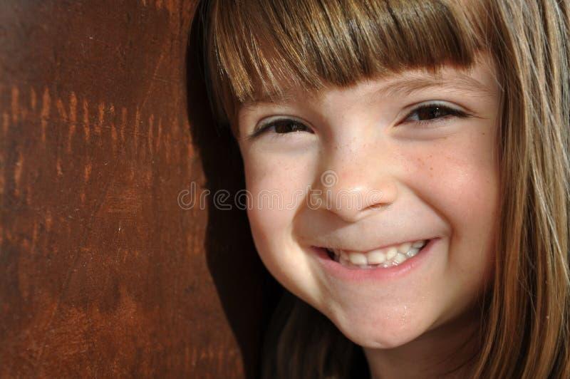 ljus flicka little nätt smil royaltyfria bilder