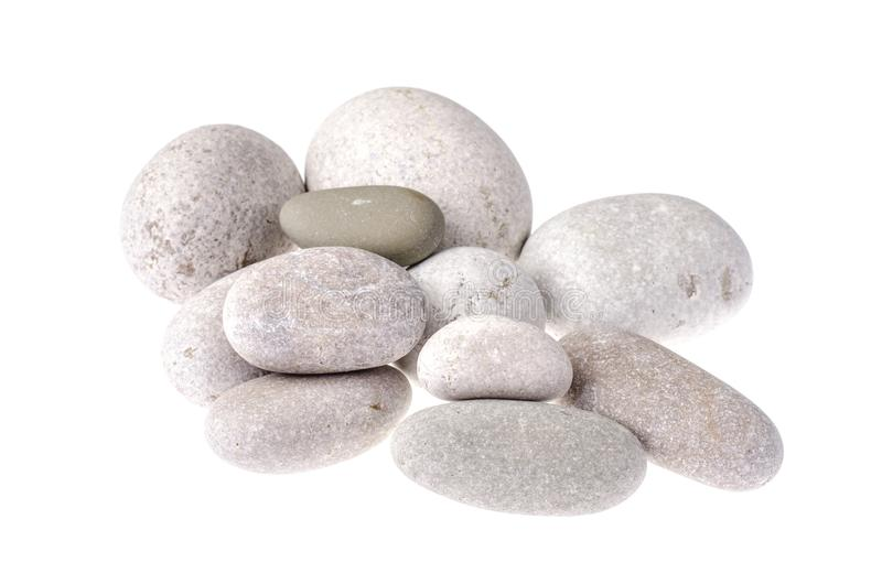 Ljus-grå färger stenar av rundad form som isoleras på vit royaltyfri bild