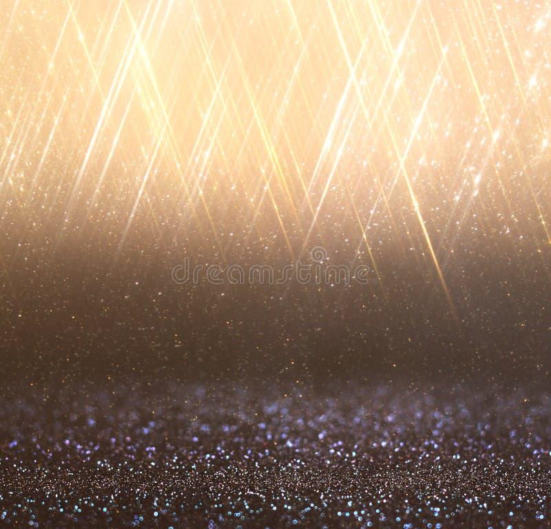 Ljus guld- bokehljus och textur Defocused abstrakt bakgrund royaltyfria bilder