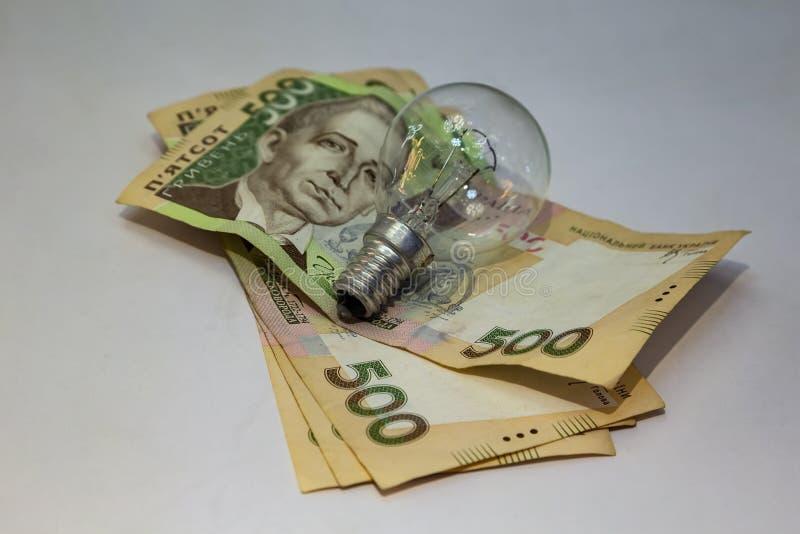 Ljus kula och pengar p arkivfoto