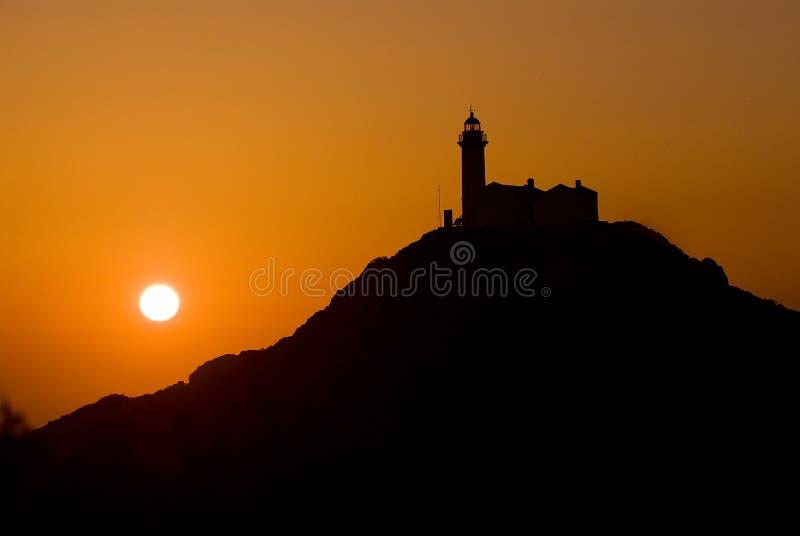 ljus romantisk solnedgång för hus royaltyfri bild