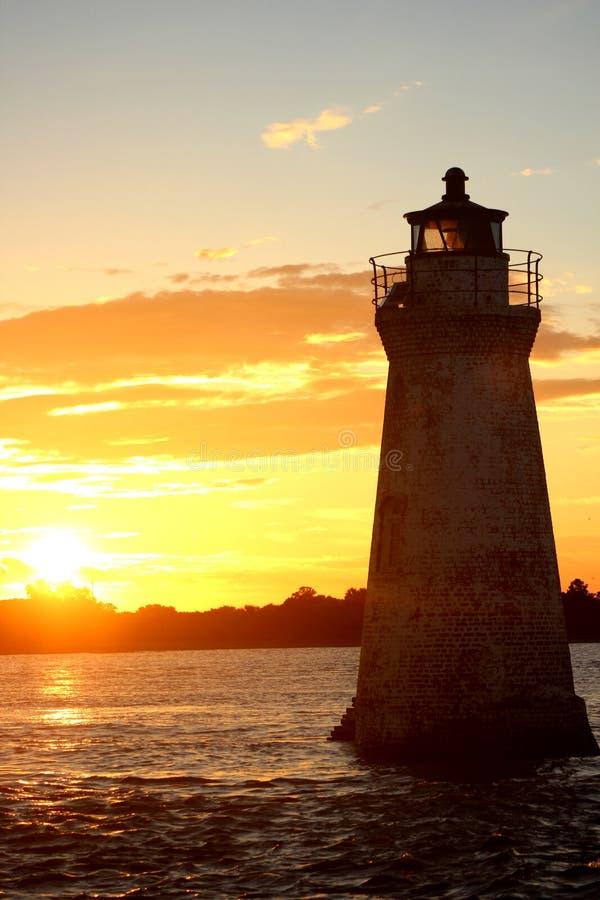 ljus solnedgång för hus arkivbilder