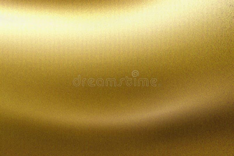 Ljus som skiner på det metalliska brädet för guld- våg, abstrakt texturbakgrund royaltyfria foton