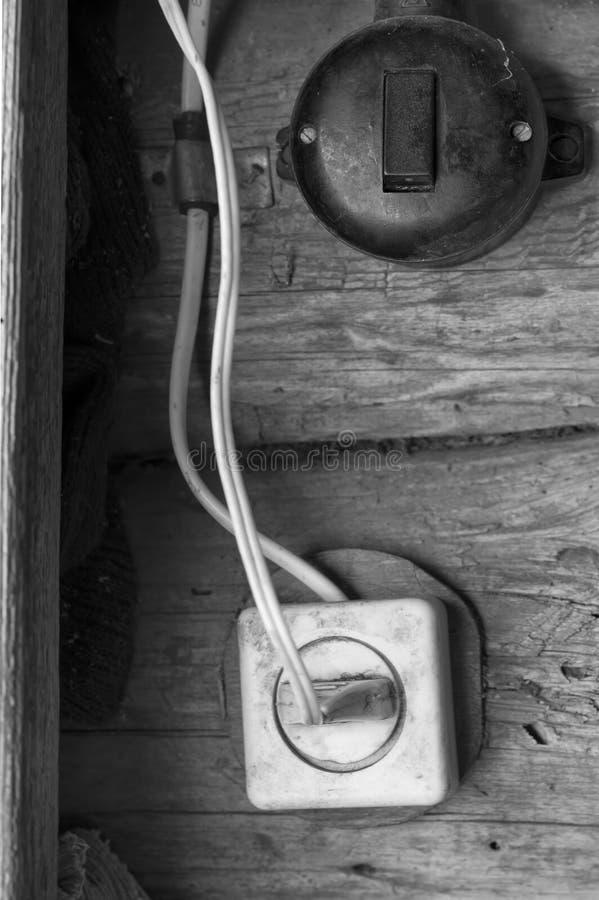 Ljus strömbrytare och hålighet arkivbild