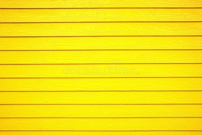 Ljus - trätexturbakgrund för gul färg fotografering för bildbyråer