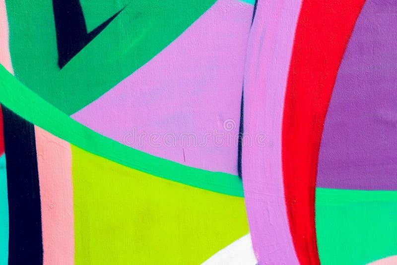 Ljus vägg med detaljen av en grafitti, gatakonst Abstrakta idérika teckningsmodefärger Modern iconic stads- kultur vektor illustrationer