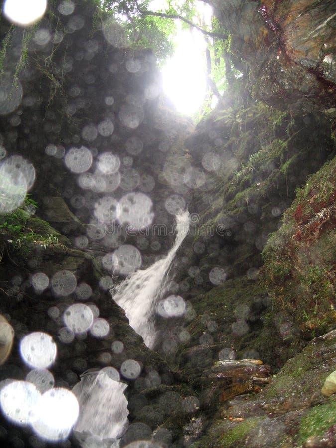 Ljusa Orbs på en vattenfall royaltyfria foton