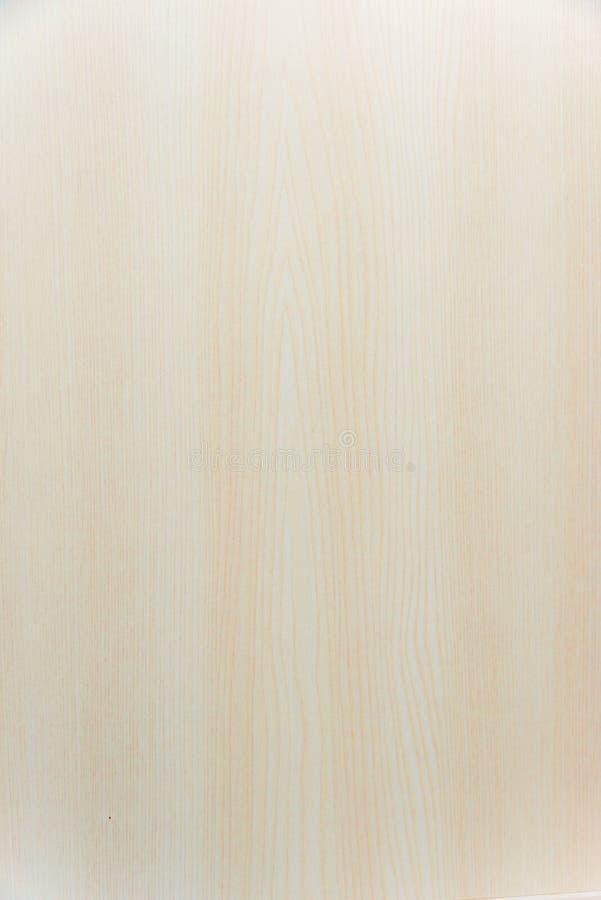 Ljusbeige bakgrund med mjuk träkornig dekaler arkivbilder