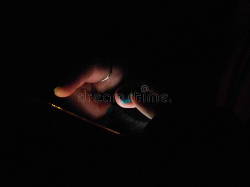 Ljusstyrkan av mobiltelefonen 2 arkivfoto