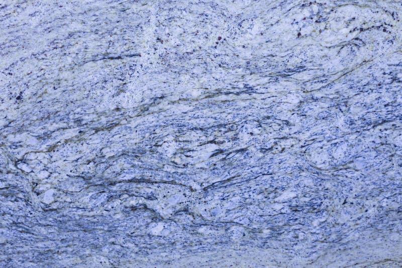 Ljust - blått granitslut upp med virvlar royaltyfria foton