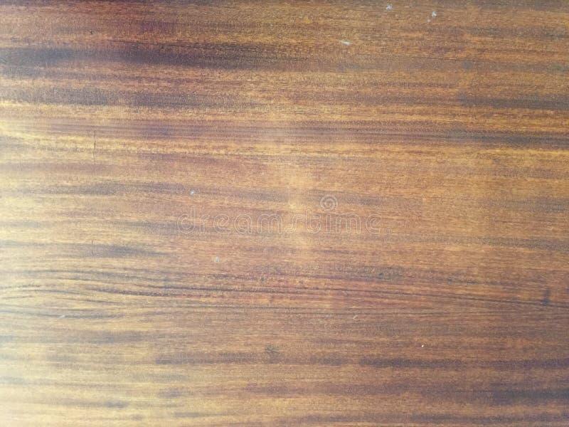 Ljust - brun bakgrundsfärg, textur av gammalt, möblemangtabell arkivbilder