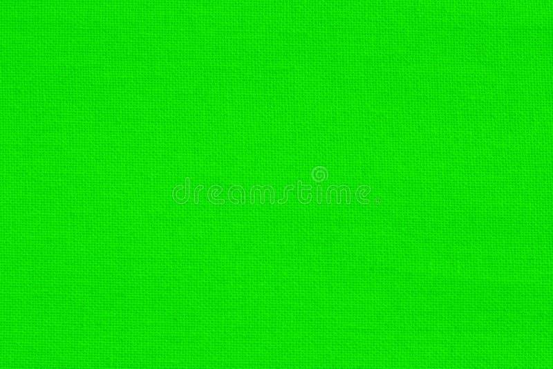 Ljust - grön bakgrund för textur för bomullstyg, sömlös modell av den naturliga textilen royaltyfri bild