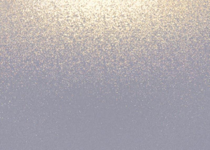 Ljust guld- skimrar damm på grå bakgrund royaltyfri bild