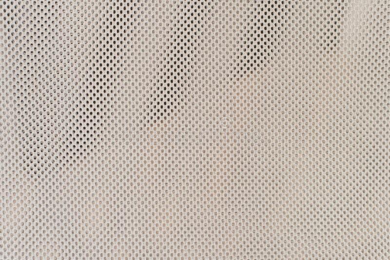 ljust ingrepp Skrynklig ljus bakgrund från ett fint raster lilla fyrkanter royaltyfri foto