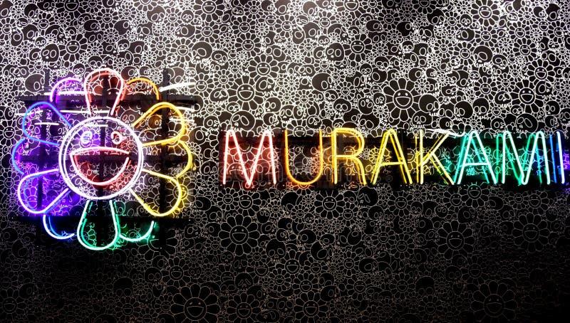 Ljust konstverk för neon av Takashi Murakami fotografering för bildbyråer