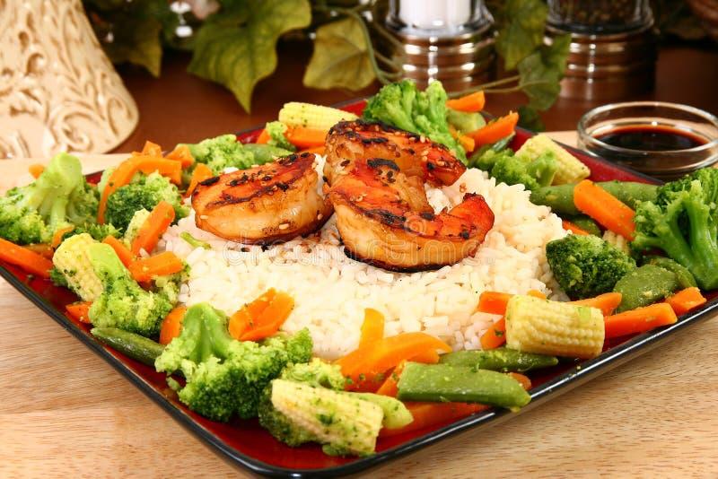 ljust rödbrun veggies för riceräkateriyaki fotografering för bildbyråer