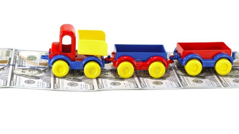 LKW-Spielzeug auf der Straße vom Geld lizenzfreie stockfotografie