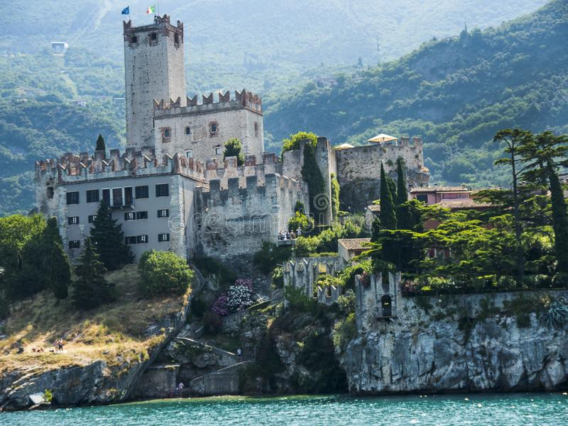 Approaching the lovely town of Malcesine on Lake Garda where is famous castle guards the entrance to its harbour.Malcesine is so s. LLake Garda is a popular stock photos