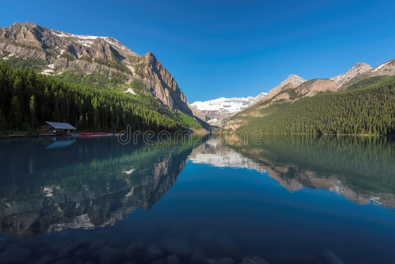 Llake Louise in Canadian Rockies, Banff National Park, Canada. Beautiful turquoise waters of the Lake Louise with snow-covered peaks above it in Rocky Mountains royalty free stock photos